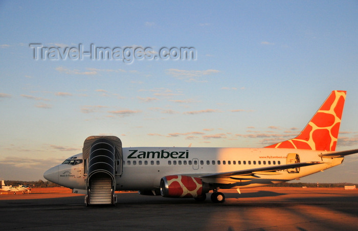 zambia8: Lusaka, Zambia: Zambezi Airlines Boeing 737-5Y0, 9J-ZJB cn 26100 - Lusaka / Kenneth Kaunda International Airport - LUN - photo by M.Torres - (c) Travel-Images.com - Stock Photography agency - Image Bank