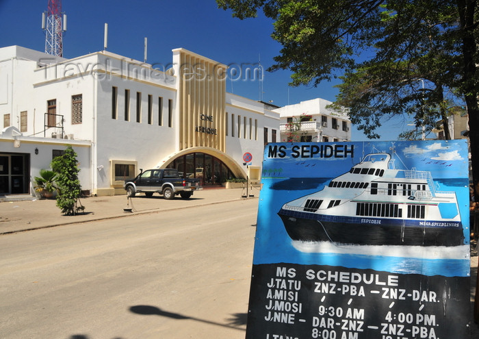 zanzibar127: Stone Town, Zanzibar, Tanzania: a ferry's schedule and Ciné Afrique - Malawi Road - Malindi area - photo by M.Torres - (c) Travel-Images.com - Stock Photography agency - Image Bank