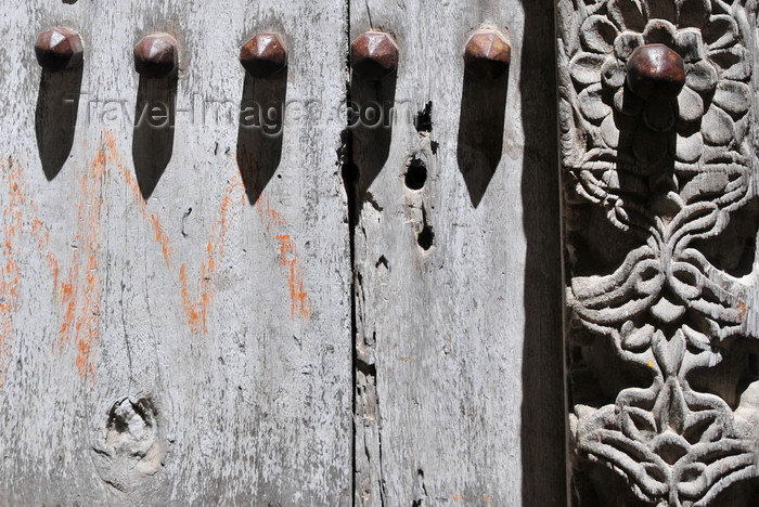 zanzibar56: Stone Town, Zanzibar, Tanzania: detail of a magnificent carved door with large metal spikes - Mizingani Road - photo by M.Torres - (c) Travel-Images.com - Stock Photography agency - Image Bank