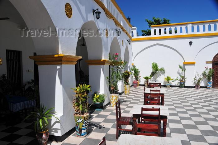 zanzibar83: Stone Town, Zanzibar, Tanzania: al fresco tables and chequered floor - terrace of the Tembo hotel - Shangani - photo by M.Torres - (c) Travel-Images.com - Stock Photography agency - Image Bank