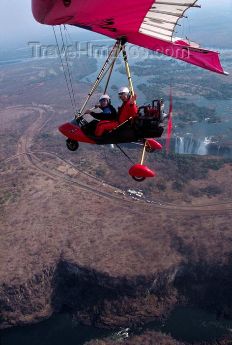 zimbabwe31: Victoria Falls - Mosi-oa-tunya, Matabeleland North province, Zimbabwe: aerial view of Victoria Falls and a Pegasus ultralight trike in flight - Zambezi River gorge on the basalt plateau - photo by C.Lovell - (c) Travel-Images.com - Stock Photography agency - Image Bank