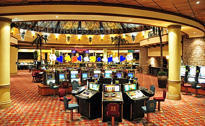 zimbabwe57: Victoria Falls, Matabeleland North, Zimbabwe: Kingdom Hotel Casino - The Kingdom At Victoria Falls - Casino area - slot machines room - photo by M.Torres - (c) Travel-Images.com - Stock Photography agency - Image Bank