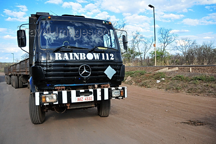 zimbabwe64: Victoria Falls, Matabeleland North, Zimbabwe: Mercedes truck at the Zimbabwe-Zambia border post - intense truck traffic crosses the border, specially carrying copper from DR Congo - 'Rainbow 112' - photo by M.Torres - (c) Travel-Images.com - Stock Photography agency - Image Bank