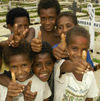 PNG - Papua New Guinea - Kids giving thumbs up, Ali Island (photo by B.Cain)