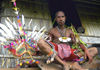 PNG - Papua New Guinea - Man sitting on porch next to his headdress, MurickLakes (photo by B.Cain)