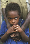 PNG - Papua New Guinea - Young boy hugged by father, Murick Lakes (photo by B.Cain)