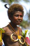 PNG - Papua New Guinea - Young boy with pig tusk necklace, Tuam Island - photo by B.Cain