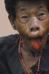 PNG - Papua New Guinea - Woman Grimacing, beetlenut stained tongue, KitavaIsland (photo by B.Cain)