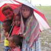 PNG - Papua New Guinea - Five children under an umbrella, Murick Lakes (photo by B.Cain)