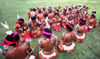 PNG - Papua New Guinea - Group of sitting female preformers, Kitava Island (photo by B.Cain)