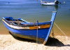 Portugal - Algarve - Alvor: old rowing boat in the harbour (photo by D.S.Jackson)