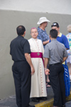 Puerto Rico - San Juan: a priest meets people (photo by D.Smith)