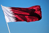 Doha, Qatar: flag of Qatar - maroon field with a broad white serrated band - Dhow harbour - photo by M.Torres