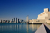 Doha, Qatar: Museum of Islamic Art and the West Bay skyscrapers - photo by M.Torres
