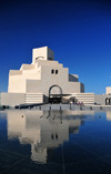 Doha, Qatar: limestone facade of the Museum of Islamic Art reflected in the pond - Doha's flagship museum - photo by M.Torres