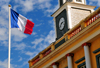Saint-Denis, Réunion: French flag flies in front of the old City Hall - Hôtel de Ville - photo by M.Torres