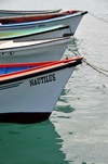 Port Mathurin, Rodrigues island, Mauritius: prows of small boats - photo by M.Torres
