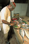 Rodrigues island: Ton Roland preparing  delicious Rodriguan food (photo by Gilbert Soobraydoo)