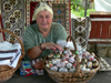 Gura Humorului, Suceava county, southern Bukovina, Romania: decorated eggs and textiles - woman at souvenir stall - photo by J.Kaman