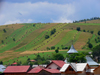 Gura Humorului, Suceava county, southern Bukovina, Romania: roof and rural landscape - long lines of haystacks - photo by J.Kaman