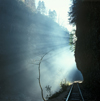 Russia - Guamskoe gorge - Krasnodar kray: ray of light over the railway line - photo by Vladimir Sidoropolev