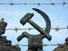 Russia - Udmurtia - Izhevsk: barbed-wire and a hammer and sickle - communist symbols (photo by Paul Artus)