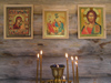 Russia - Solovetsky Islands: inside an Orthodox chappel - icons and candles - photo by J.Kaman