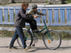 Russia - Solovetsky Islands: help - boy learning to ride a bike - photo by J.Kaman
