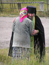 Russia - Solovetsky Islands: Russian Orthodox Priest - comforting a member of the flock - photo by J.Kaman