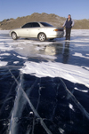 Lake Baikal, Irkutsk oblast, Siberian Federal District, Russia: car on the frozen lake surface - locals routinely drive on the ice - photo by B.Cain