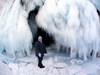 Lake Baikal, Irkutsk oblast, Siberian Federal District, Russia: woman at the entrance of an ice cave on Olkhon island - photo by B.Cain