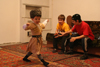 Chechnya, Russia - a boy wearing Chechen national costume and dancing traditional Chechen dance - photo by A.Bley