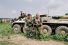 Chechnya, Russia - Chechen warriors pose near a Russian APC destroyed in Chechnya war - photo by A.Bley