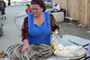Chechnya, Russia - Grozny - Chechen woman in market sells traditional Chechen dish - sausages - photo by A.Bley
