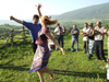 Chechnya, Russia - man and woman dancing traditional Chechen dance in meadow - photo by A.Bley