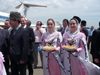 Chechnya, Russia - Grozny - two Chechen women welcomes the guests in airport dressed in national Chechen costume - photo by A.Bley