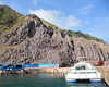 Fort Bay, Saba: catamaran Samantha in the harbour - cliffs - photo by M.Torres