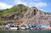 Fort Bay, Saba: harbour buildings and unstable rock slope - dive shops - photo by M.Torres