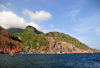 Fort Bay, Saba: harbour and hills seen from the sea - jagged volcanic landscape - photo by M.Torres