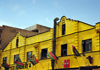 Johannesburg, Gauteng, South Africa: Bree St - yellow façades of historical wharehouses with SADC countries flags - photo by M.Torres