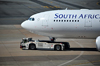 Johannesburg, Gauteng, South Africa: South African Airways Airbus A330-243 ZS-SXX (ex F-WWYL), cn 1223 with Goldhofer AST-1 Towbarless Tug operated by Swissport - OR Tambo International / Johannesburg International Airport / Jan Smuts / JNB - Kempton Park, Ekurhuleni - photo by M.Torres
