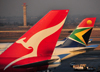 Johannesburg, Gauteng, South Africa: aircraft tails - Qantas and South African Airways - Qantas Boeing 747-438 VH-OJO 'The Spirit of Australia' (cn 25544/894) - OR Tambo International / Johannesburg International Airport / Jan Smuts / JNB - Kempton Park, Ekurhuleni - photo by M.Torres