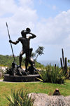 Col de la Tourmente, St. Barts / Saint-Barthélemy: Arawak warrior armed with a lance and sounding a conch shell - pelican and iguana - photo by M.Torres