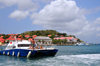 Gustavia, St. Barts / Saint-Barth�lemy: a divers' boat returns to the harbour - museum and local government buildings in the background - tip of Gustavia Peninsula - photo by M.Torres