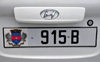 Gustavia, St. Barts / Saint-Barth�lemy: car license plate - St Barts coat of arms - Maltese cross, the Fleur-de-lis, crown, pelicans, and the island's Amerindian name Ouanalao - Hyundai - photo by M.Torres