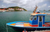 Gustavia, St. Barts / Saint-Barth�lemy: blue boat in the harbour - Fort Oscar, museum and H�tel de la Collectivit�  in the background - photo by M.Torres