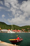Gustavia, St. Barts / Saint-Barth�lemy: small boat and the green hills around the harbour - photo by M.Torres