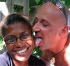 St Lucia: Castries - St Lucia Jazz festival - tongue in cheek - white man and black woman - photo by P.Baldwin