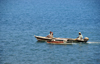 Neves, Lemb� district, S�o Tom� and Pr�ncipe / STP: fishermen in an outrigger / pescadores num mini-catamaran - photo by M.Torres