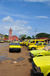 S�o Tom�, S�o Tom� and Pr�ncipe / STP: yellow taxis on Concei��o avenue - old Toyotas - Concei��o church in the background / taxis amarelos na Avenida Concei��o - igreja da Concei��o em fundo - photo by M.Torres